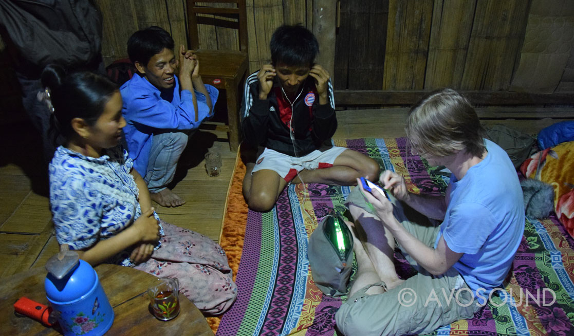 Listening to sound recordings in a jungle hut somewhere in Myanmar